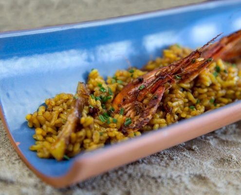 Rice dish of cuttlefish and red prawns