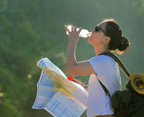 Photo of a woman sipping on his journey